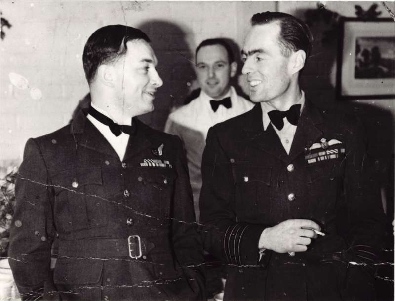 Jock Moncrieff, Leonard's Wireless Operator with 35 Squadron and Leonard Cheshire at a Black tie event during the Second World War.