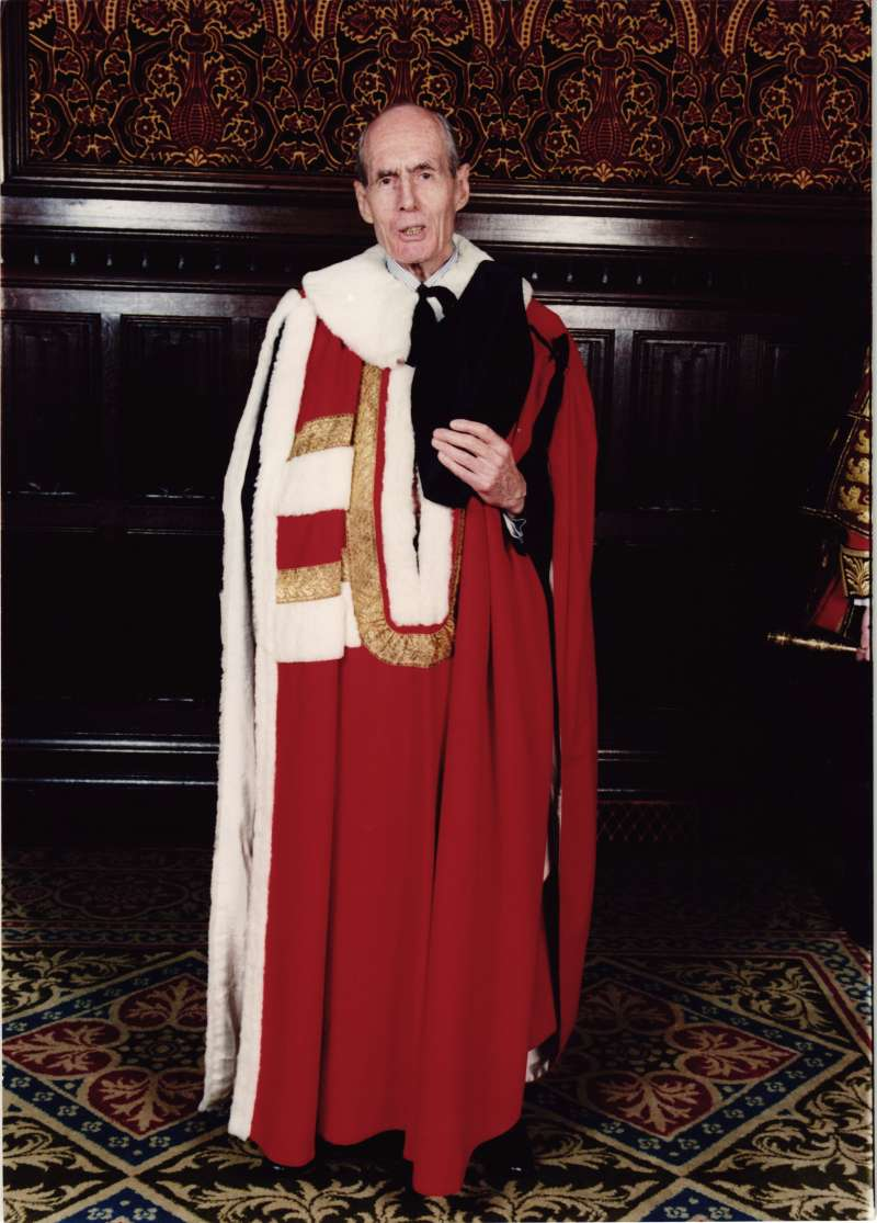 An older Leonard Cheshire dressed in peer's robes on the occasion of his investiture