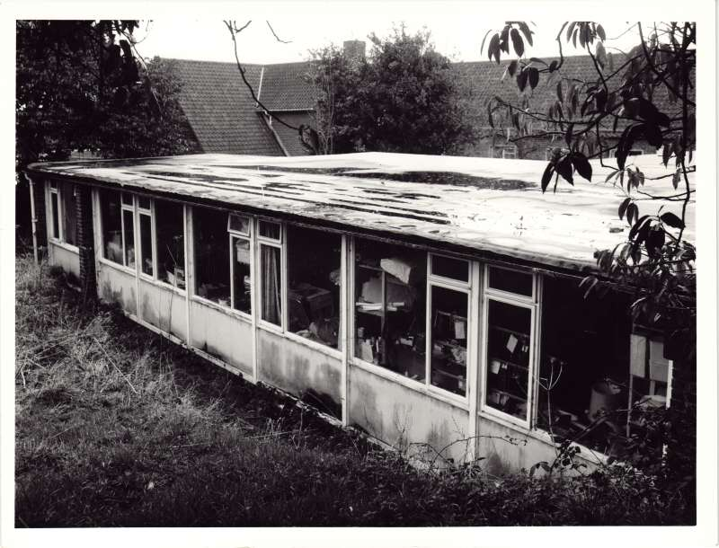 Exterior view of a single storey building used as a workshop