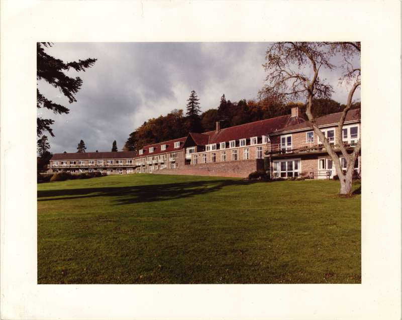 Colour photo showing the lawns and buildings at Le Court