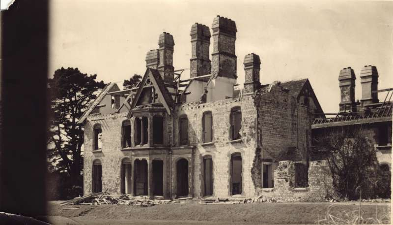 An old building in ruins, with no roof or glass in the windows