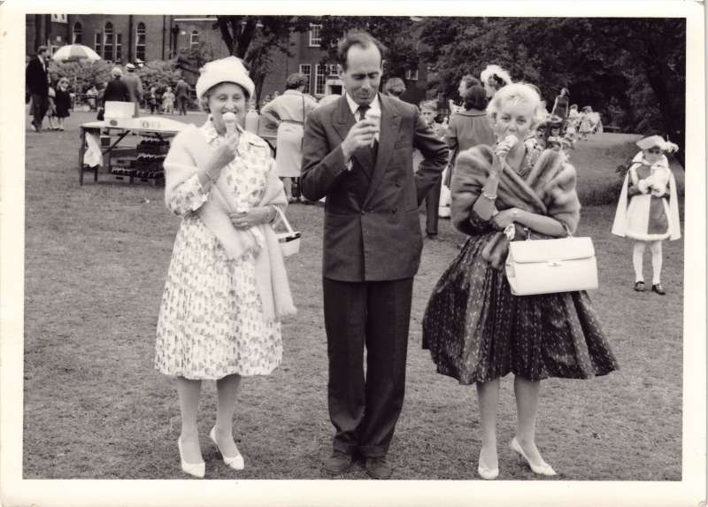 Leonard Cheshire with two women at a fete day, all holding and eating ice cream cones
