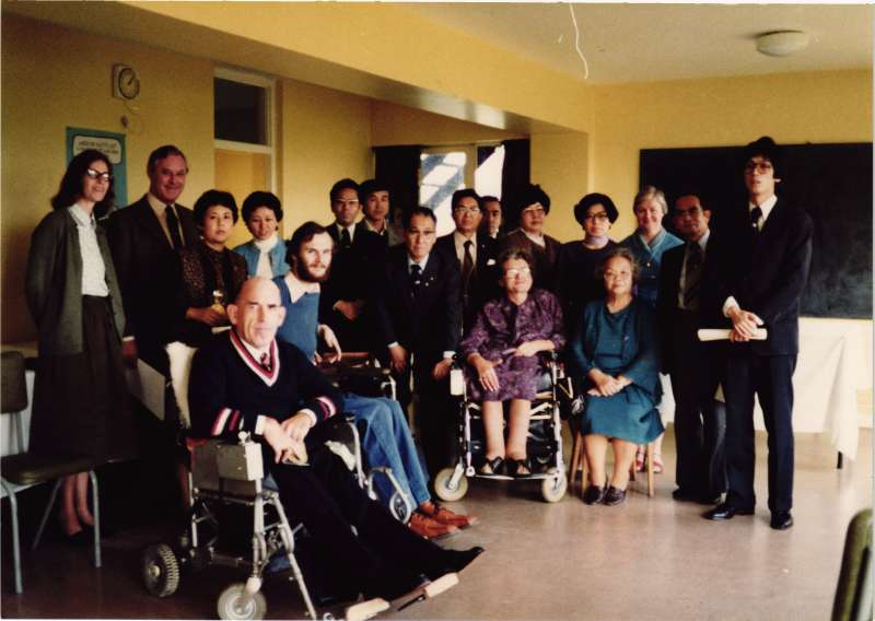 A group photo of residents and staff with visitors from Japan