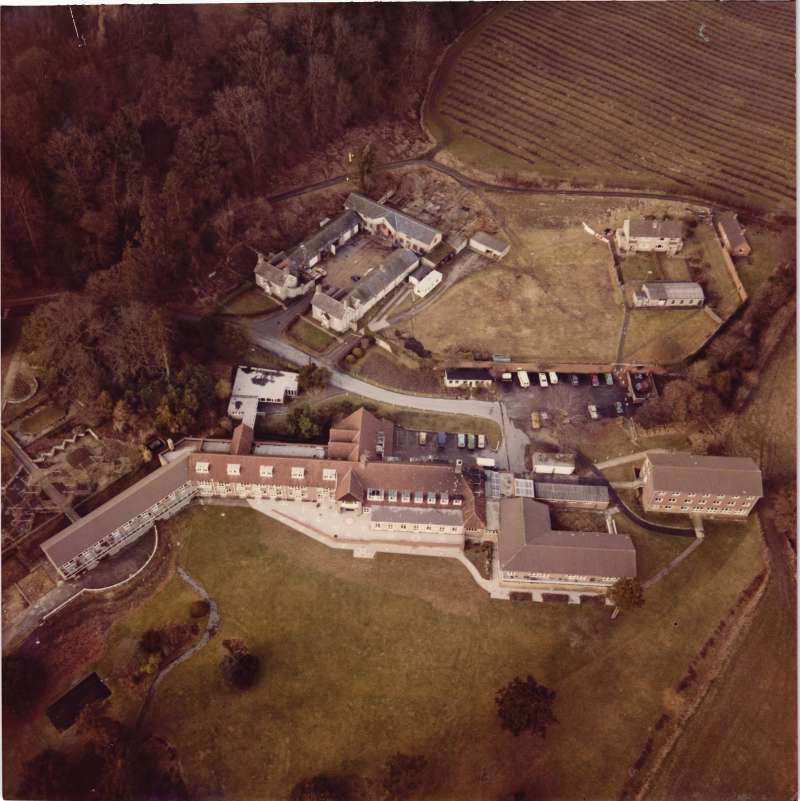 Colour aerial view of the Le Court estate buildings and grounds
