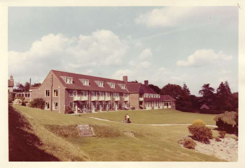 Colour photo showing the new Le Court building and gardens