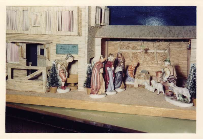 Close up shot of a crib and stable Christmas scene made from matchsticks, with model animals and people