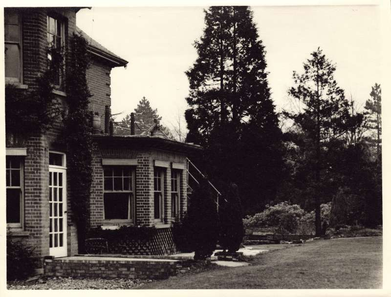 Photo of the back doorway, windows and gardens at St Cecilia's
