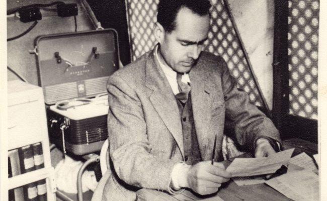 Leonard reading at a desk