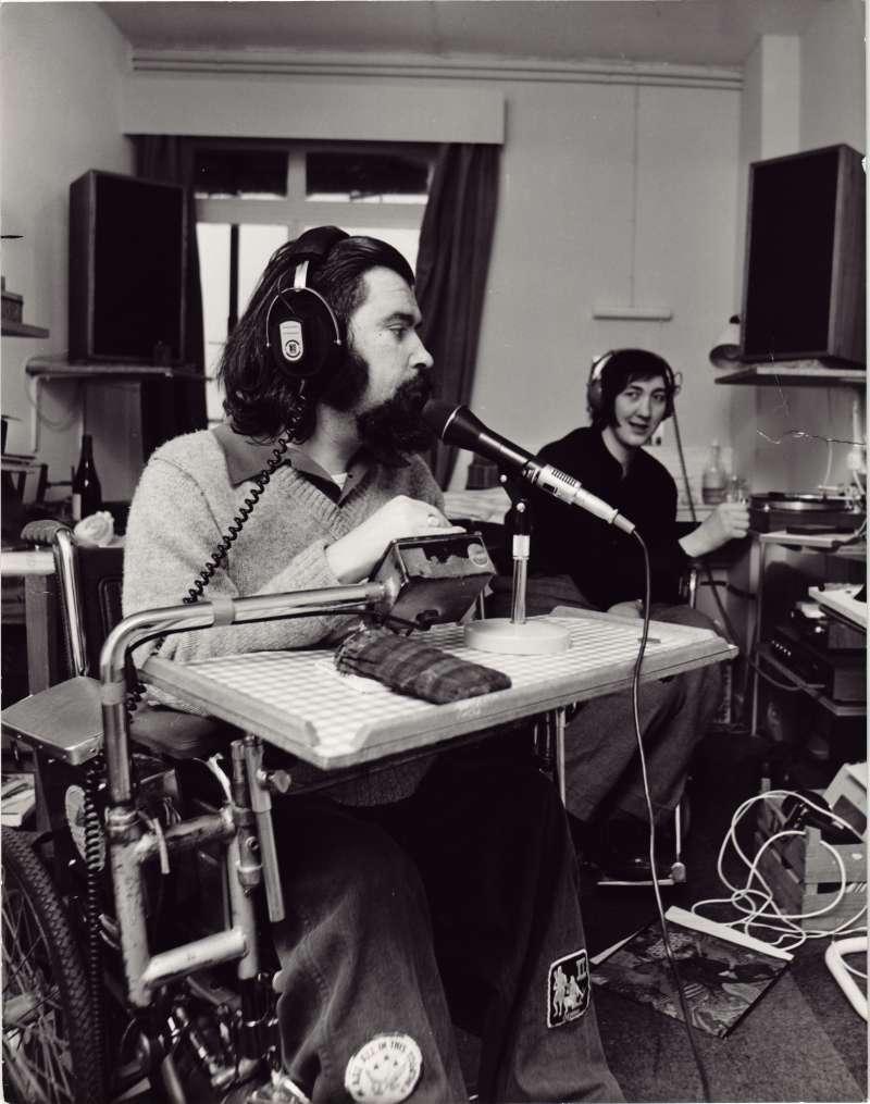 Two men sat in a recording studio